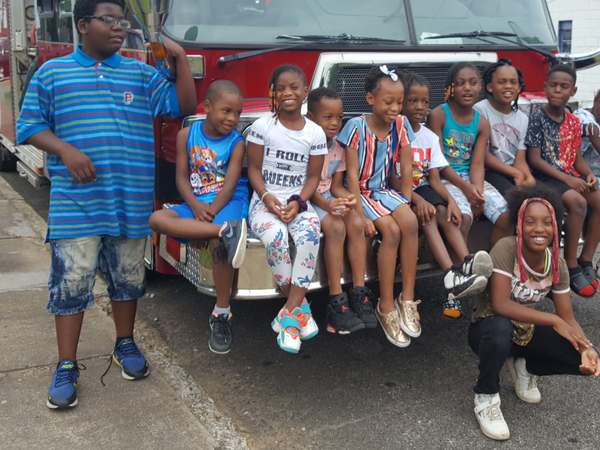 group image of kids sitting on firetruck